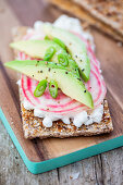 Baked crispbread with cottage cheese, striped beetroot and avocado