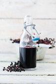 Elderberry juice in a flip-top bottle