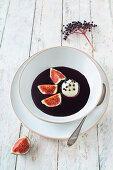 Cold elderberry soup with vegan semolina dumplings and fresh figs