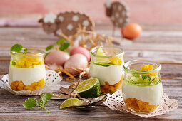 Yogurt cream with lime and mango in glasses for Easter