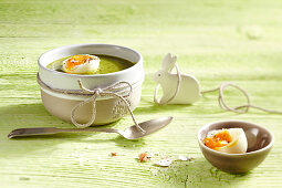 Spinach soup with boiled eggs for Easter