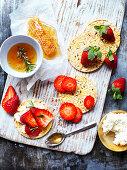 Cottage cheese corn thin with strawberries and lemon rosemary honey