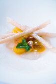 Glazed mirabelles with crispy almond sticks and wine jelly