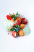 Melon balls and strawberries in a port wine broth with parsley foam