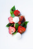 strawberries with balsamic glaze, goat's cheese balls and basil