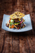 Beef teriyaki with stir-fried vegetables and sesame seed crisps