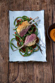 Lamb chops with a ginger crust, yard-long beans and mashed sweet potato
