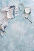 Surface with icing sugar and teatowel