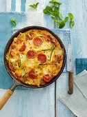 Frittata with courgettes, peppermint, tomatoes and mozzarella