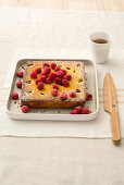 Corn and almond cake with raspberries