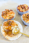 Baked apple muffins with caramel sauce