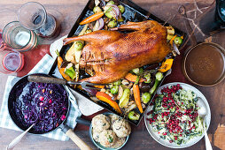 Roast goose with oven-roasted vegetables, bread dumplings, apple red cabbage, creamy savoy cabbage and lingo berry compote