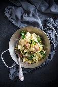 Tagliatelle with soya, chickpeas, onions, peas and rocket (vegan)