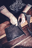 Black croissants with active charcoal powder being made: pastry triangles being cut