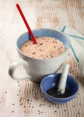 A hot drink with black sesame seeds