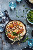 Chicken legs in creamy mushroom, pepper and garlic sauce with fresh taragon