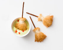 Crispy witches brooms with guacamole