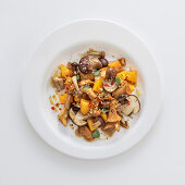 Fried mixed mushrooms with pumpkin and chillis