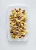 Candele pasta in a white-wine sauce with sausage meat, green grapes and bay leaves