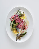 Oven-roasted seabream with lemon and bay leaves