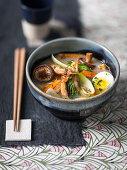 Shoya ramen with pork, prawns, egg and mushrooms
