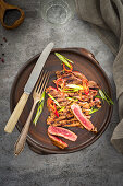 A grilled beefsteak sprinkled with chilli and spring onion