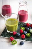 Red and green smoothies with berries