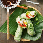 Vegetarian spring rolls on a banana leaf