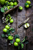 A still life with Bramley apples on a wooden background (top view)