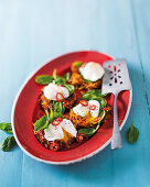 Curried vegetable röstis with poached eggs