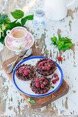 Chocolate tarts with raspberries