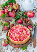 Pie with baked custard cream and apple roses