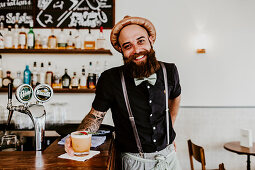 A man with a beard at a bar (Grande Café & Bar, Zurich, Switzerland)
