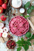 Apple pie with raspberry powder and raspberries (unbaked)