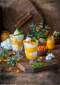 Trifles with meringue, cream and sea buckthorn curd