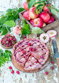 Apple pie with dried raspberry powder and raspberries