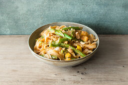 Vegan rice noodles with a fruity mango and peanut sauce