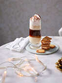 Puff pastry biscuits with pink pepper and a hot coconut and coffee drink with whipped cream