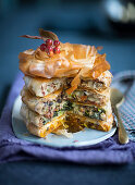 A spicy filo pastry cake with a vegetable and sausage filling