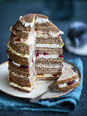 A panettone sandwich cake with various layers of cheese