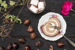 Roulade fillled with chestnut cream and marshmallows is best eaten with hot chocolate