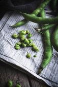 Broad beans on newspaper