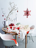 A table laid for Christmas in white and red