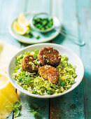 Fishcakes with pea-fried rice
