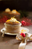 Chestnut muffin baked in a glass with orange cream and zest (Christmas)
