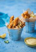 Cornflake coated fish strips and sweet potato fries