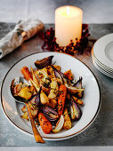 Roasted root vegtables for Christmas (carrots, parsnips, red onions, apples and potatoes)