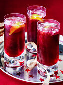 Cranberry juice coolers with lemon slices