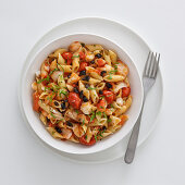 Pennette with stockfish, date tomatoes and olives