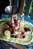 Cherry juice with limes and oranges being filled into bottle